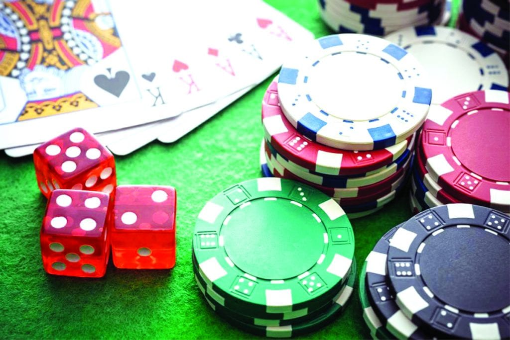 poker chips and cards on a table