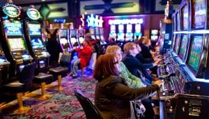 a couple of elderly women playing slots