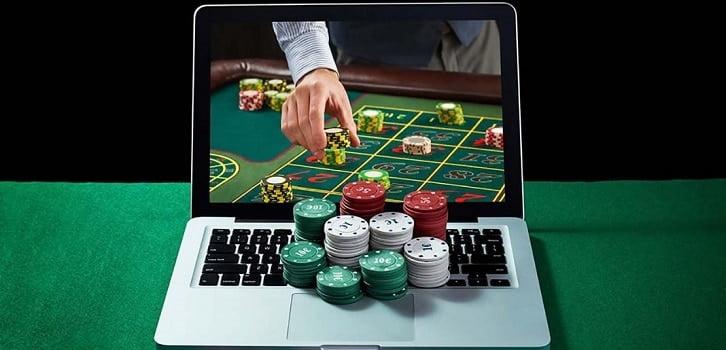 poker chips on a laptop