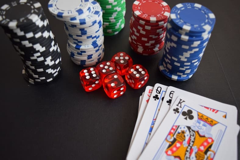 a table with cards, cubes and poker chips on it