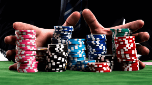 a man pushingstacks of poker chips with his hands