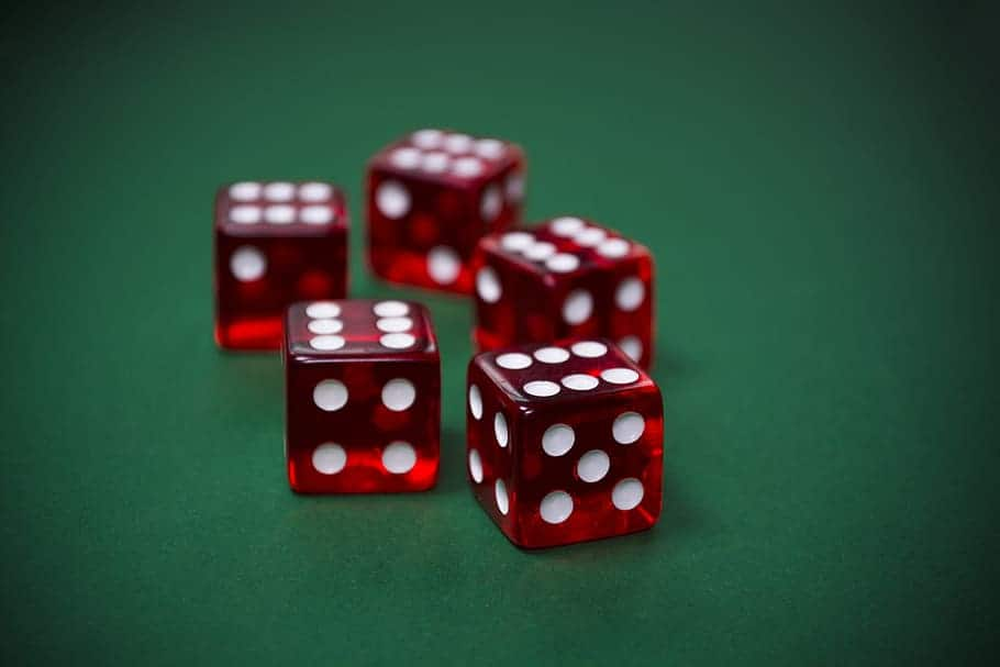 red dices on a green table