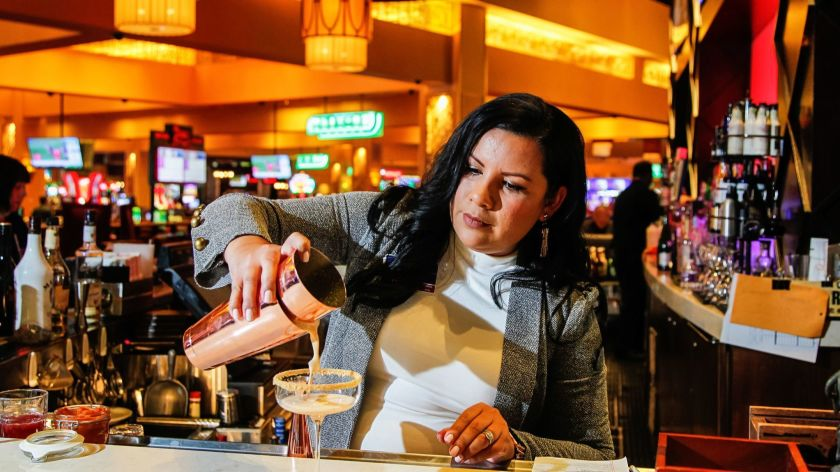 a female bartender pouring a drink