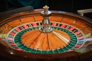 wooden roulette wheel with a white little ball