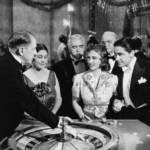 a group of watching the dealer throw the white ball, circa the 1940