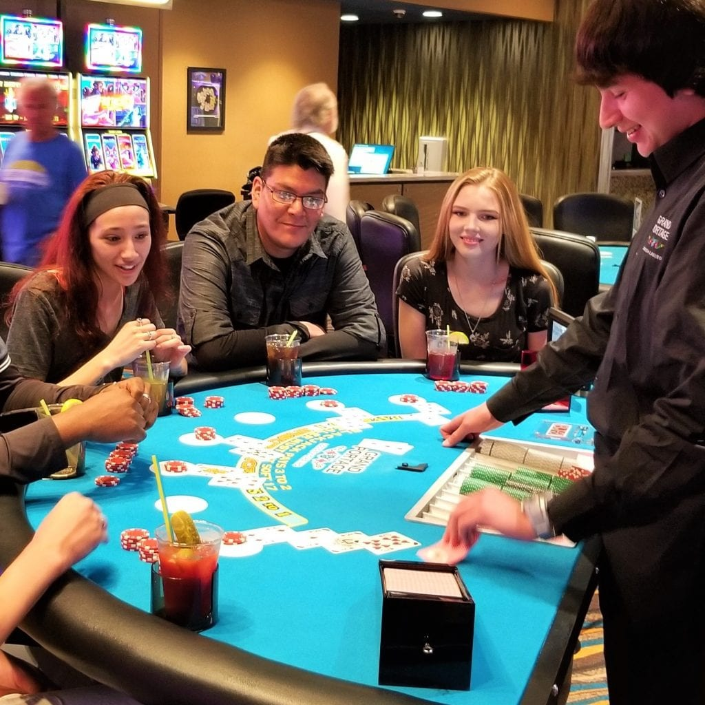 casino dealer with his customers on a casino table